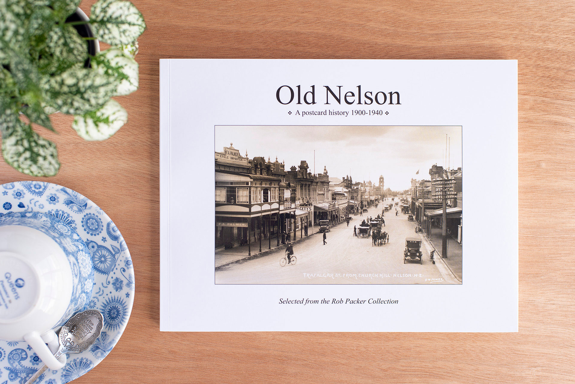 Old Nelson, A postcard history 1900-1940 book cover by Barney Brewster, Rob Packer and Nikau Press, photo taken by Nana Jones